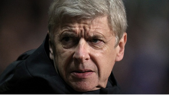 Arsenal boss Arsene Wenger looks worried by form