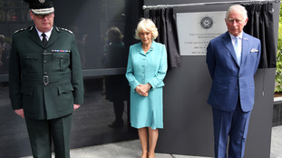 The Prince of Wales and Duchess of Cornwall unveiling the Police Service of Northern Ireland Memorial Book.