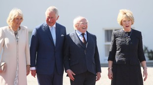Charles and Camilla are welcomed to Dublin by President Michael D Higgins and his wife.