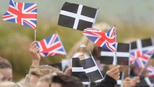 The Cornish flag being waved on St Piran's day.