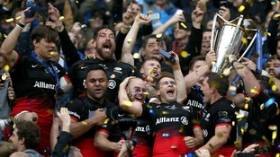 Saracens players celebrate winning the European Champions Cup trophy in 2016