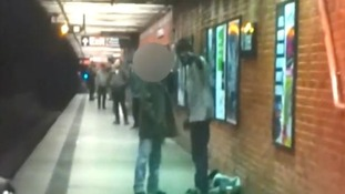 The argument between the two men at a New York City subway station