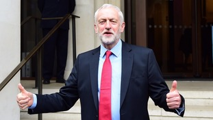 Jeremy Corbyn gives a thumbs up on the campaign trail in London.