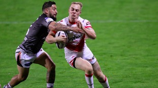 Castleford Tigers' Rangi Chase, left, tackles St Helens' Adam Swift