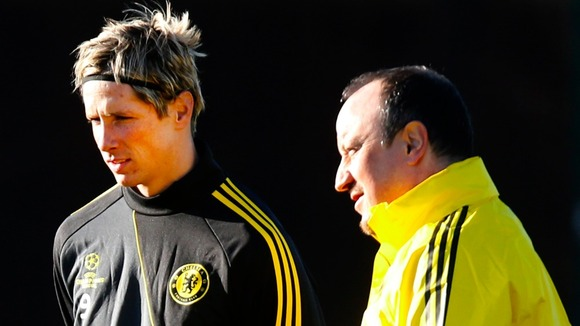 Fernando Torres chats with interim boss Rafa Benitez during Chelsea training