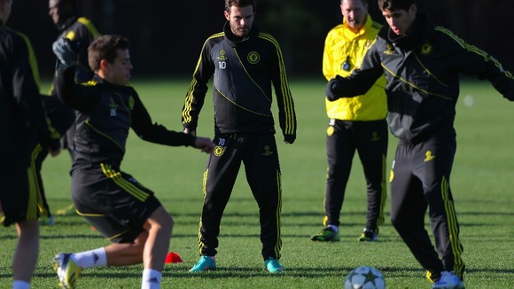 Chelsea's in-form midfielder Juan Mata watches on in Tuesday training