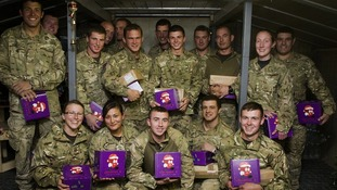 Soldiers at Forward Operating Base, Shawqat, Helmand, with last year's boxes