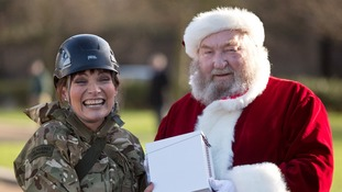 Lorraine Kelly with uk4u trustee Allan Simms dressed as Santa