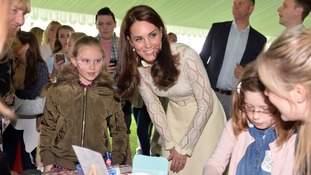 The Duchess of Cambridge talks to children at the Party in the Palace event.