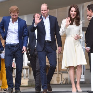 Prince Harry and the Duke and Duchess of Cambridge arrive at the tea party.