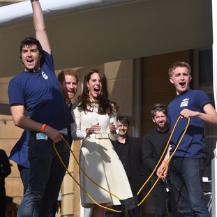 Prince Harry and the Duchess of Cambridge shoot water bombs into the crowd.
