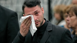 Andrei Burnaz, the boyfriend of Andreea Cristea, at her funeral.
