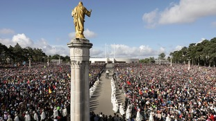 The statue of Our Lady of Fatima is carried in a procession for a Mass celebrated by Pope Francis.