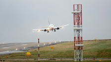 A stock image of a plane coming in to land at Leeds Bradford Airport.