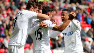 Swansea city players celebrating