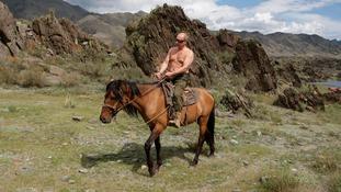 Putin riding in Siberia