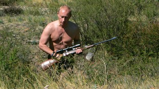 Putin roams the brush with a hunting rifle