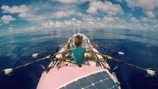 Women rowing a boat across Pacific