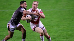 Rangi Chase making a tackle agains St Helens