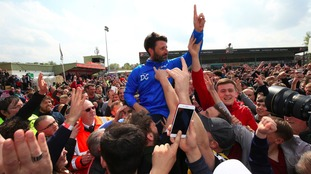 Danny Cowley is lifted aloft by grateful Lincoln City fans