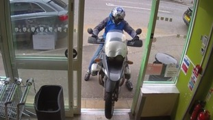 Man captured on camera trying to ride into shop