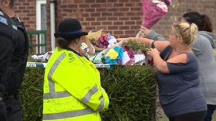 Tributes were left outside the house in Halstead last August