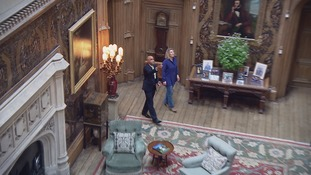 Cary is shown around the hall made famous in the ITV drama