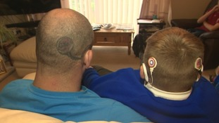 Devoted dad gets hearing implants tattooed on head so his deaf son doesn't feel alienated