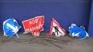 road signs hit by trains