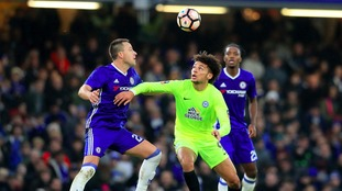 Lee Angol in action for Peterborough against Chelsea in the FA Cup.