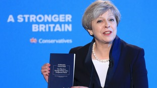 Theresa May holding the Conservative manifesto