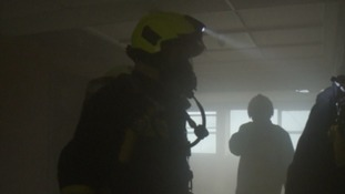 Firefighters using breathing apparatus.