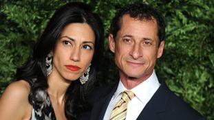 Anthony Weiner (r) pictured alongside estranged wife Huma Abedin.