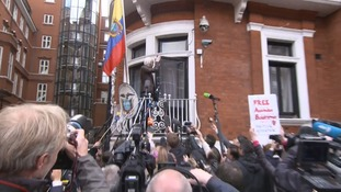 Julian Assange refused to answer questions after addressing the media from the embassy balcony.