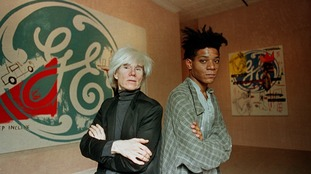 Jean-Michel Basquiat with Andy Warhol, New York, 1985.
