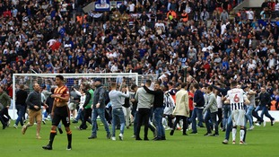 Fans stormed the pich at fulltime
