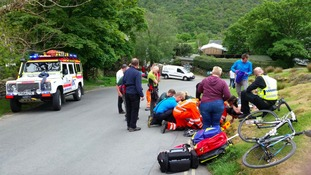 On the way to the first rescue, the Cockermouth team stopped to help a cyclist.