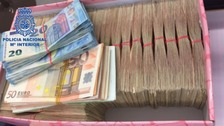 More than £100,000 in Euros was seized in the raids.