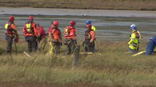 Recovery workers struggled to retrieve the bodies.