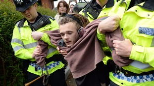 The protester was grabbed by police as Theresa May arrived at the Welsh Conservative manifesto launch.