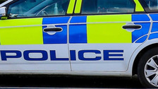 Officers injured after camper van rams police car