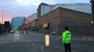 A police officer stands guard close to Manchester Arena.
