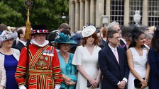 Buckingham Palace guests hold minute's silence