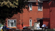 Police raid an address in Manchester linked to Abedi.