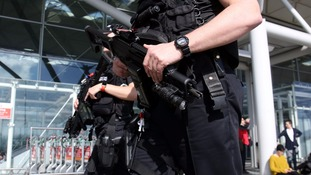 File photo of armed police outside London Stansted airport.