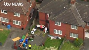 Police at Abedi's family home in Manchester.