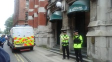 Officers stand guard outside Granby House