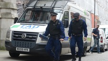 Armed police raid a block of flats near to Manchester Piccadilly Station