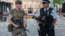 Armed soldiers and police officers pictured on the streets of Westminster in the aftermath of the Manchester terror attack