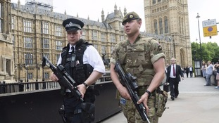 The military is providing armed guards for key locations across London after the terror threat level was raised.